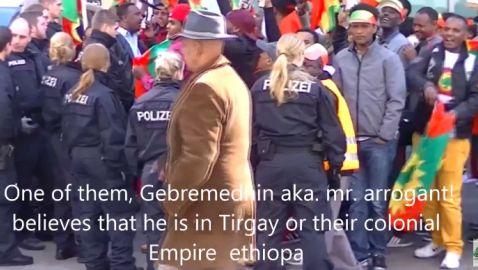 Video: Ethiopian Govt Official in Berlin Gestures Inappropriately at Oromo Protesters Opposing TPLF's Land-Grabbing Policy in Oromia & Elsewhere in the South (Apr. 18, '15)